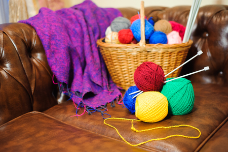 color knitting and balls in the basket