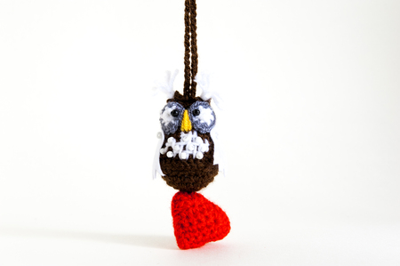 Knitted owl Valentines Day on the white backgrounde.