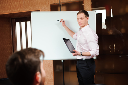 Businessman explaining business plan to coworkers in conference Standard-Bild - 122001444