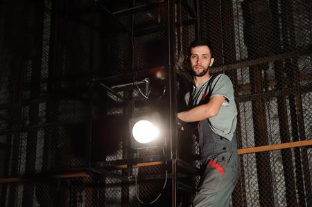 The lighting engineer adjusts the lights on stage Stock fotó