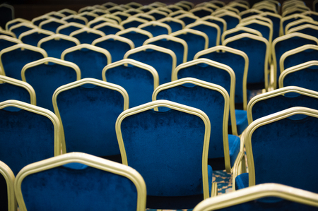 Empty cinema auditorium. a large number of blue velvet chairs in a row. Standard-Bild - 122099255