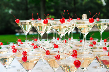 Pyramid of champagne outdoors in the park. Imagens