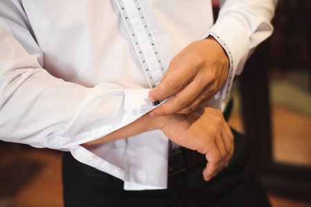 Young businessman puts a suit on before meeting with partners. Archivio Fotografico