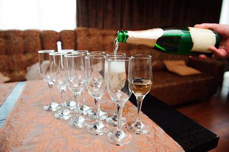 Waiter pours champagne in glasses, luxury event. Stock Photo