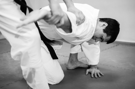 Fight between two aikido fighters. Sport in kimono.