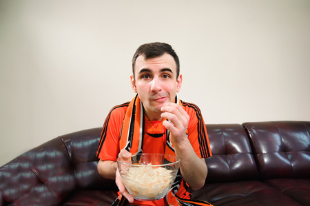 Man watching football, drink beer, football fan