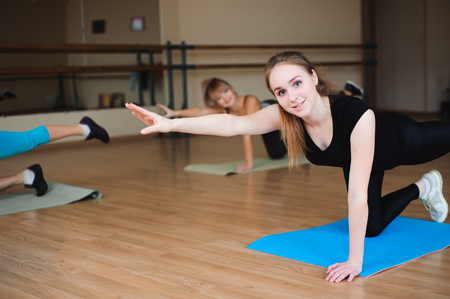 Women doing sport in gym, healthcare lifestyle people concept, modern studio