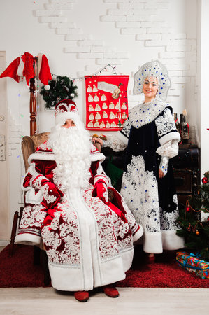 Russian Christmas characters: Ded Moroz, Santa and Snegurochka, snow girl posing in the studio