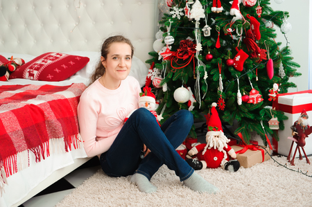 Wish you a Merry Christmas. Girl with a Christmas presents. Happy feeling to New Year.