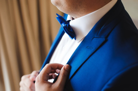wedding details - elegant groom dressed wedding tuxedo costume