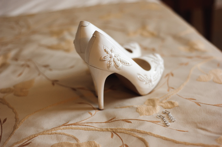 Bride wedding details - wedding shoes as a backgrond