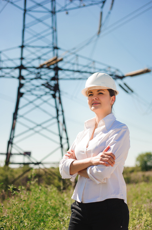 beautiful woman engineer work at an electrical substation.