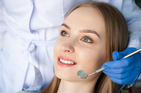 Dental clinic. Dentist examining a patients teeth.
