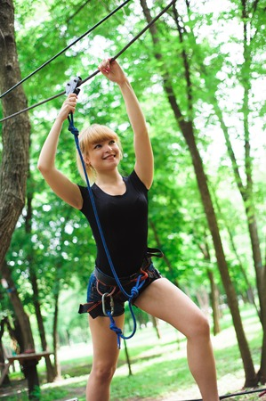 Hiking in the rope park beautiful sports girl 版權商用圖片