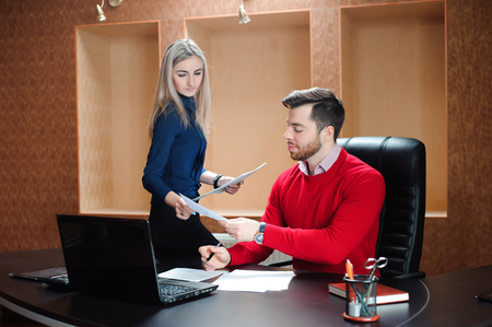 Business partner sitting at the table in front of a compute