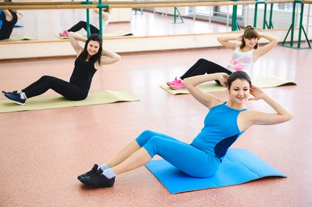 Group of people at the gym in a stretching class Foto de archivo