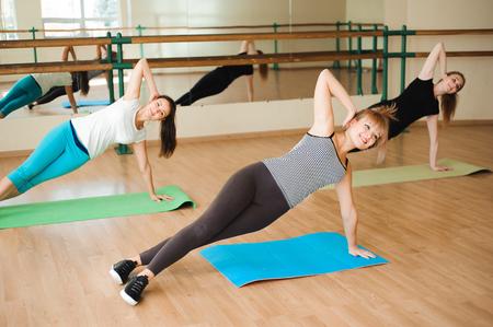 Women doing sport in gym, healthcare lifestyle people concept, modern loft studio. 版權商用圖片