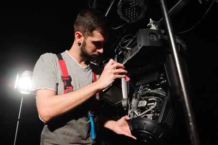 The lighting engineer adjusts the lights on the stage.