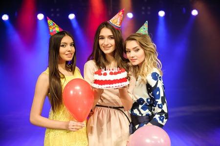 cheerful young company celebrates birthday in a nightclub