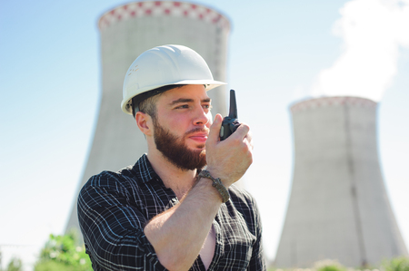 Portrait of a builder engineer with a radio set in his hand. Imagens