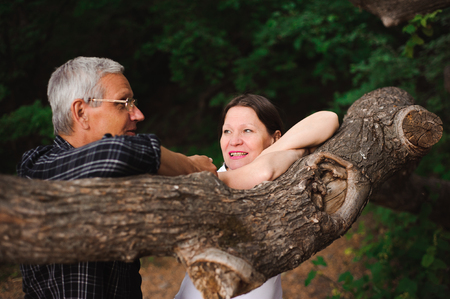 Senior couple walking together in a forest, close-up.