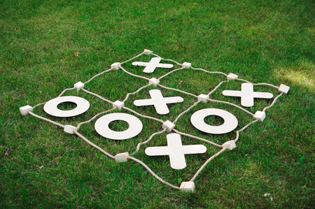 Tic tac toe game. Game on green grass