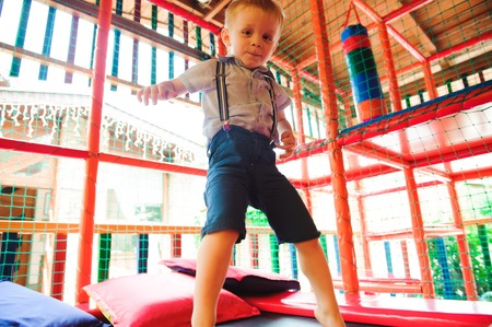 Boy playing on the playground, in the childrens maze.