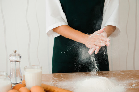Chef preparing dough - cooking process, work with flour. Stockfoto