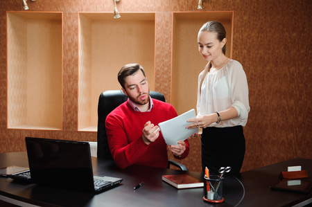 Smiling business specialist and secretary working in modern office. Imagens
