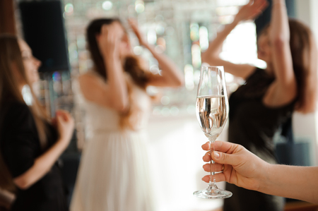 Group people with champagne dancing at the party Stockfoto