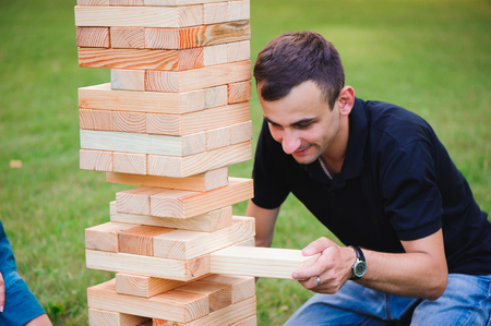 The tower from wooden blocks. Group game of physical skill with big blocks Banque d'images - 122657685