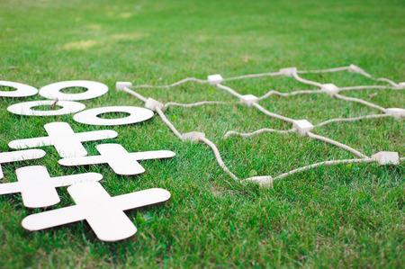 Tic tac toe game. Game on green grass Фото со стока - 122657729