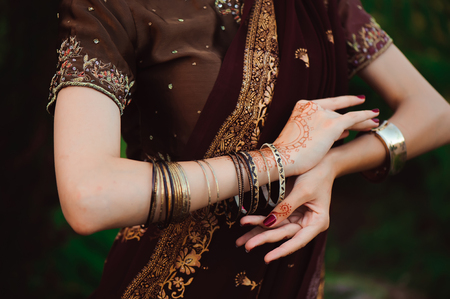 Woman Hands with black mehndi tattoo. Hands of Indian bride girl with black henna tattoos. Fashion. India 写真素材