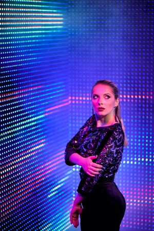 Model woman in neon light. Art design of female disco dancers posing in UV. Isolated on neon background.