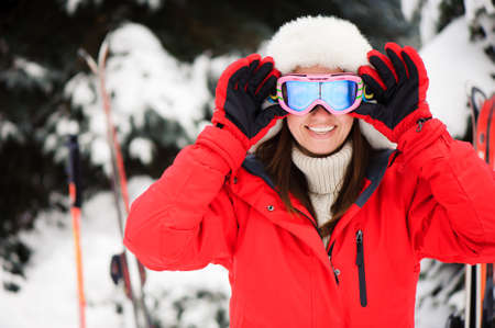 Skiing. Snow scoot in the forest. Winter sports. Girl in the winter forest skiing.