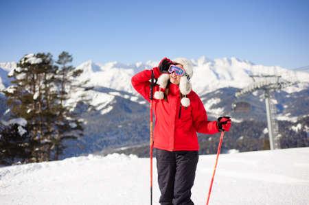 young woman is skiing at a ski resort