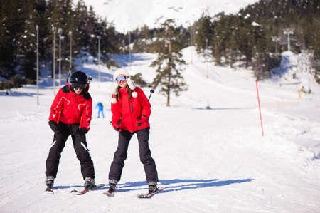 Happy friends having fun in Mountains ski resort - nature and sport picture. 版權商用圖片