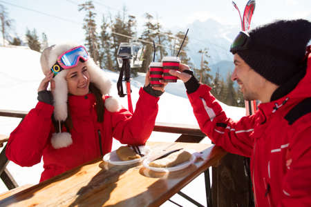 husband and wife relax after skiing having fun in the ski resort