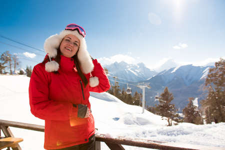 Happy woman in snowy mountains. Winter sport vacation.