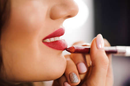 Red Lipstick. Closeup Of Woman Face With Bright Red Matte Lipstick On Full Lips. Beauty Cosmetics, Makeup Concept. High Resolution Image Stockfoto
