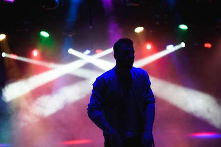 silhouette of male dancer in a night club Foto de archivo