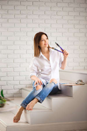 Girl with brushes in a Painting Studio