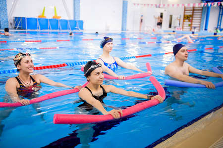 Aqua aerobics training in the water sports center.