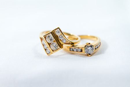Couple of Diamond engagement gold ring with white isolated background Reklamní fotografie