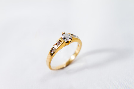 Diamond engagement gold ring with white isolated background