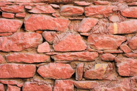 has been: Brick wall that has been painted red