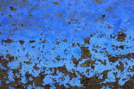 ruinous: Brick wall that has been painted blue Stock Photo