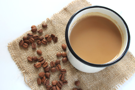 spaciousness: Cup of Coffee and Coffee Beans