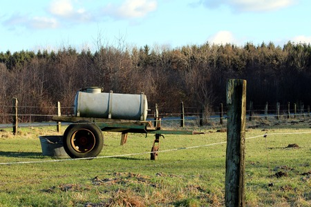 expiration: Trailer for water on a Pasture