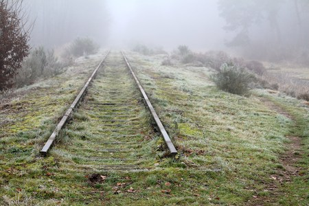 Old disused railway line in the fog